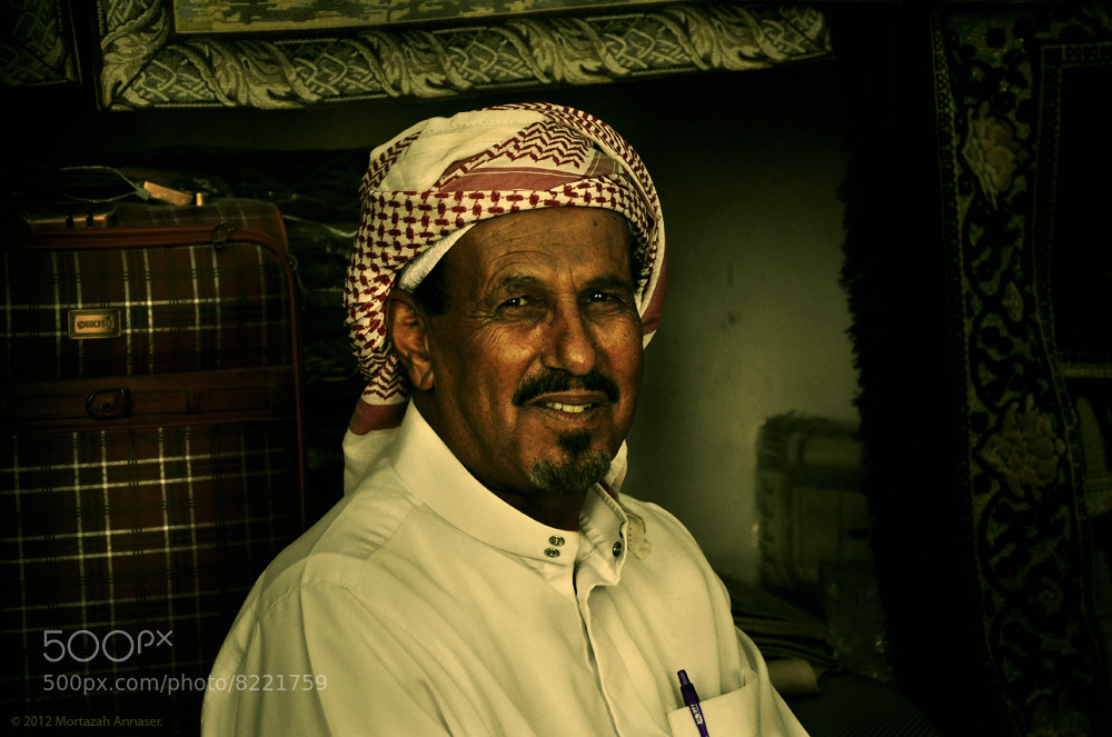 Photograph Textiles Seller : بائع المنسوجات by Mortazah  on 500px