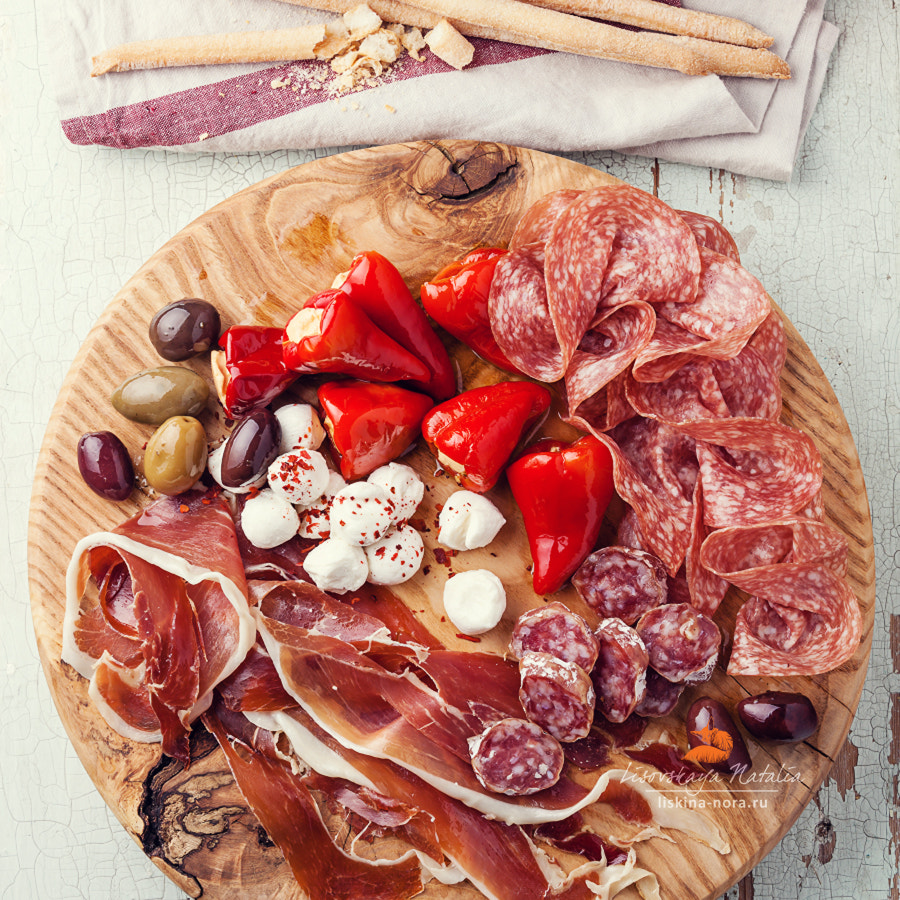 Cold meat plate and grissini bread sticks