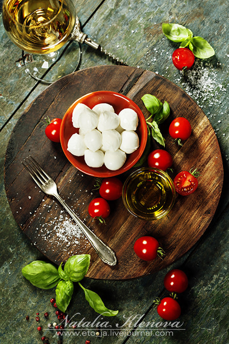 Photograph Cherry tomatoes, basil leaves, mozzarella cheese and olive oil f by Natalia Klenova on 500px