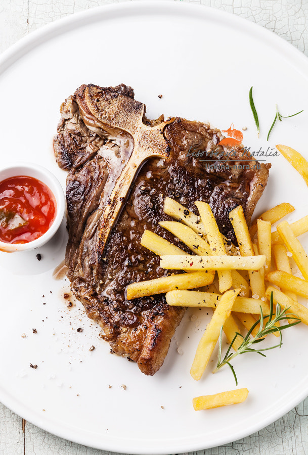 T-Bone Steak with Salted french fries on white plate