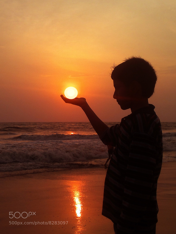 Photograph Holding the Sun.......... by Aroon Kalandy on 500px