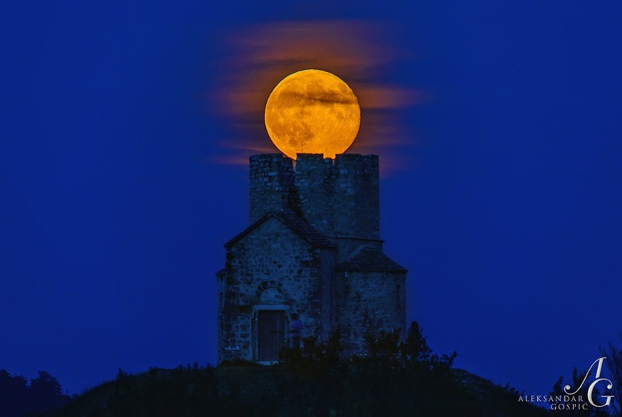 Super Moon as the crown of St. Nicholas 12th century church near Nin