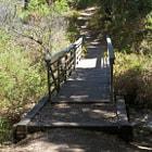 A wood bridge over a dry creek along the Backbone Trail in Malibu, California.