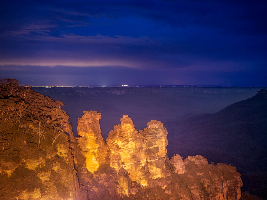 Photograph Three Sisters Glowing at Night by Travis Chau on 500px