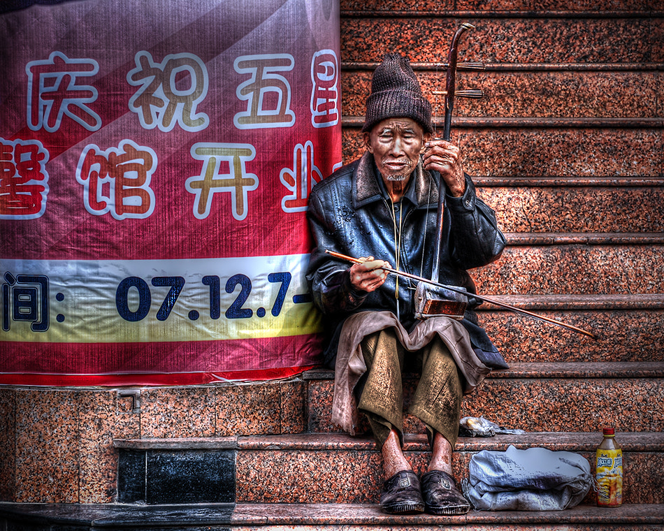Photograph The Busker by Michael Steverson on 500px