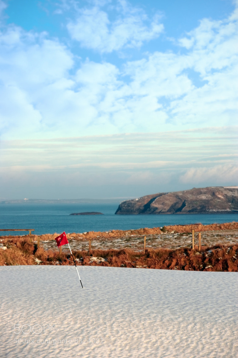Photograph snow covered golf course and cliffs by David Morrison on 500px