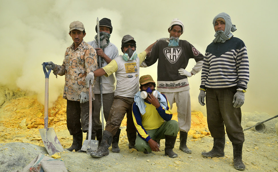 Photograph Sulfur miners in Ijen volcano by Ori Ron on 500px