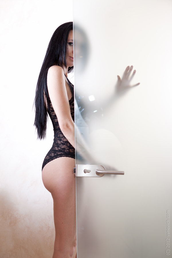 Photograph behind the glass door by Andrey Yanevich on 500px