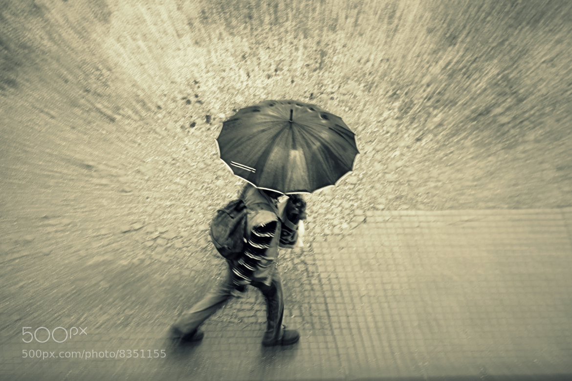 Photograph walking in the rain by Raquel Camurasiquel on 500px