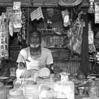 Постер, плакат: Old man and his shop