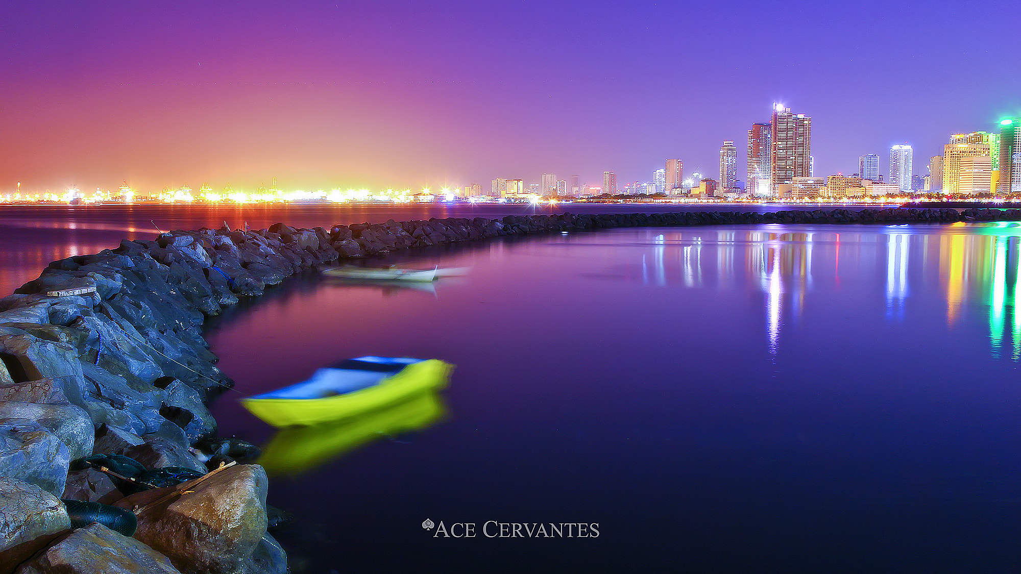 Photograph Boats in Bright City Lights by Ace Cervantes on 500px