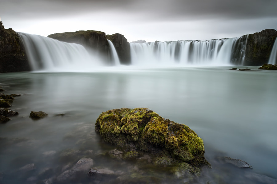 The Goðafoss (Icelandic: waterfall of the gods or waterfall of the goði) is one of the most spectacular waterfalls in Iceland. It is located in the Mývatn district of North-Central Iceland at the beginning of the Sprengisandur highland road. The water of the river Skjálfandafljót falls from a height of 12 meters over a width of 30 meters.  In the year 999 or 1000 the Lawspeaker Þorgeir Ljósvetningagoði made Christianity the official religion of Iceland. After his conversion it is said that upon returning from the Alþingi, Þorgeir threw his statues of the Norse gods into the waterfall. Þorgeir's story is preserved in Ari Þorgilsson's Íslendingabók.  Named after the waterfall was MS Goðafoss, an Icelandic ship carrying both freight and passengers, that was sunk by a German U-Boat in World War II, resulting in great loss of lives.