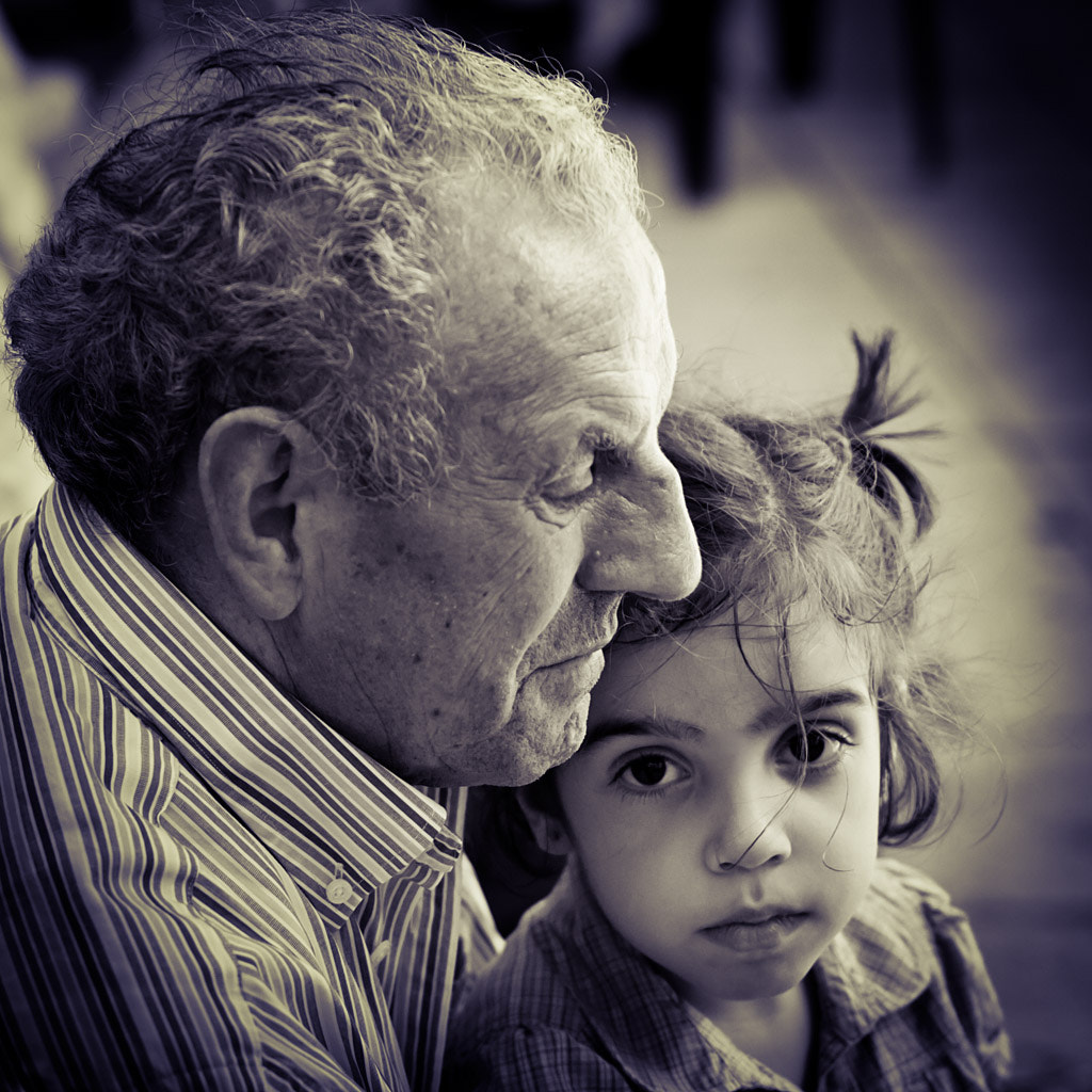 Photograph Grandfather and granddaughter by Miguel Darco on 500px