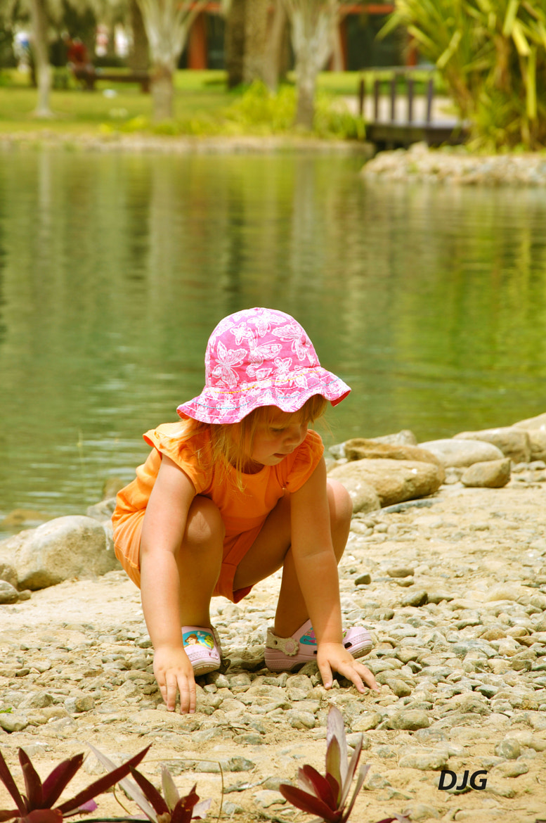 Photograph Girl with pink cap by Jeyaganesh Duraimani on 500px