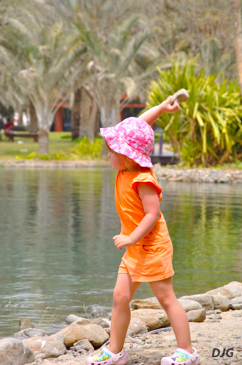 Photograph girl with the pink cap 2 by Jeyaganesh Duraimani on 500px