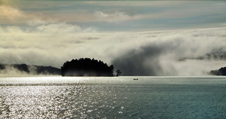 Photograph boating in the mist by Andrzej Pradzynski on 500px