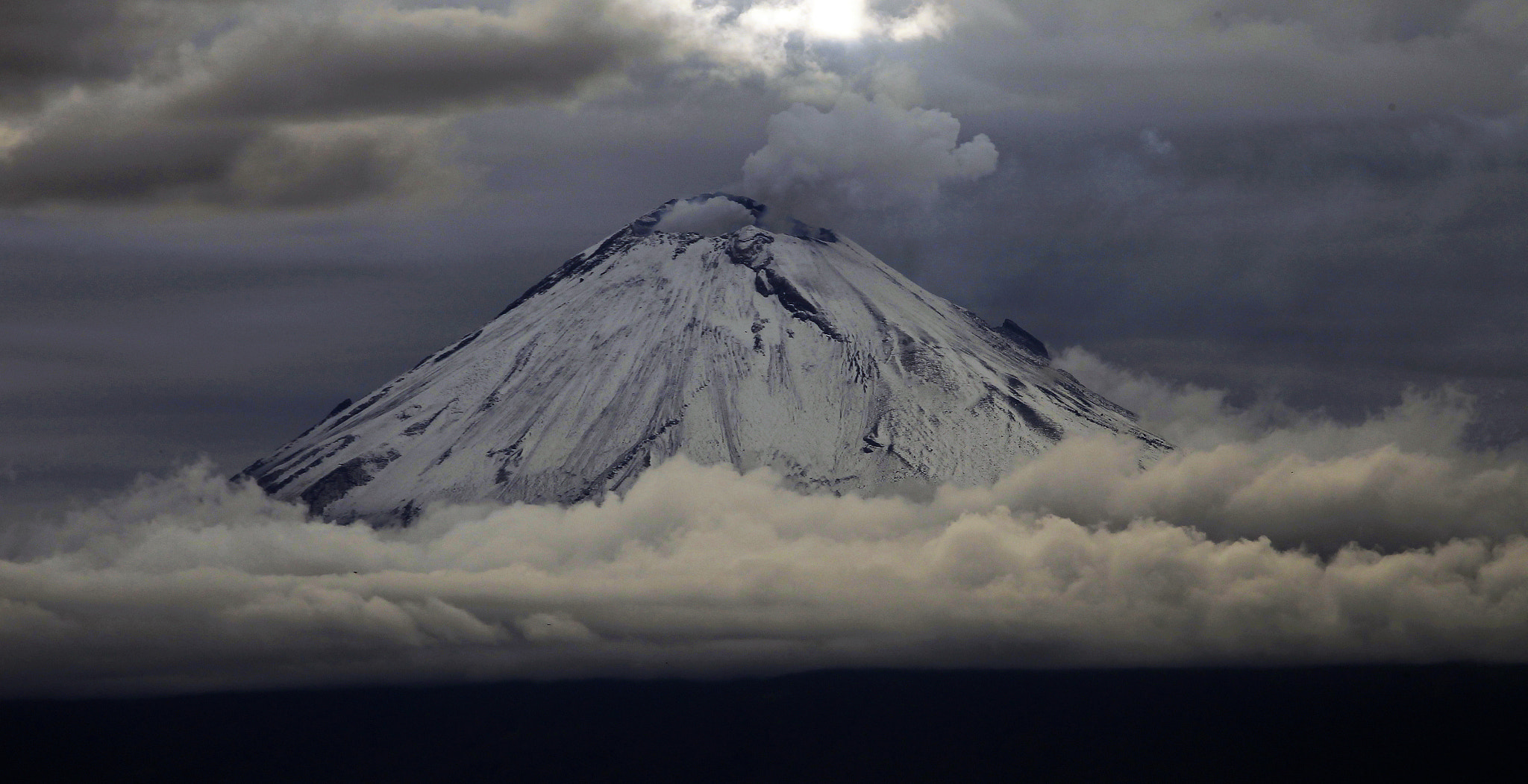 Photograph snow, clouds and volcano by Cristobal Garciaferro Rubio on 500px