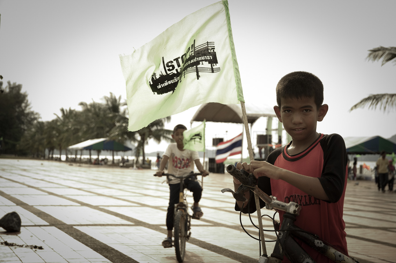 Photograph child with the flag of protest. in Satun, South of Thailand by Supachai Salaeman on 500px