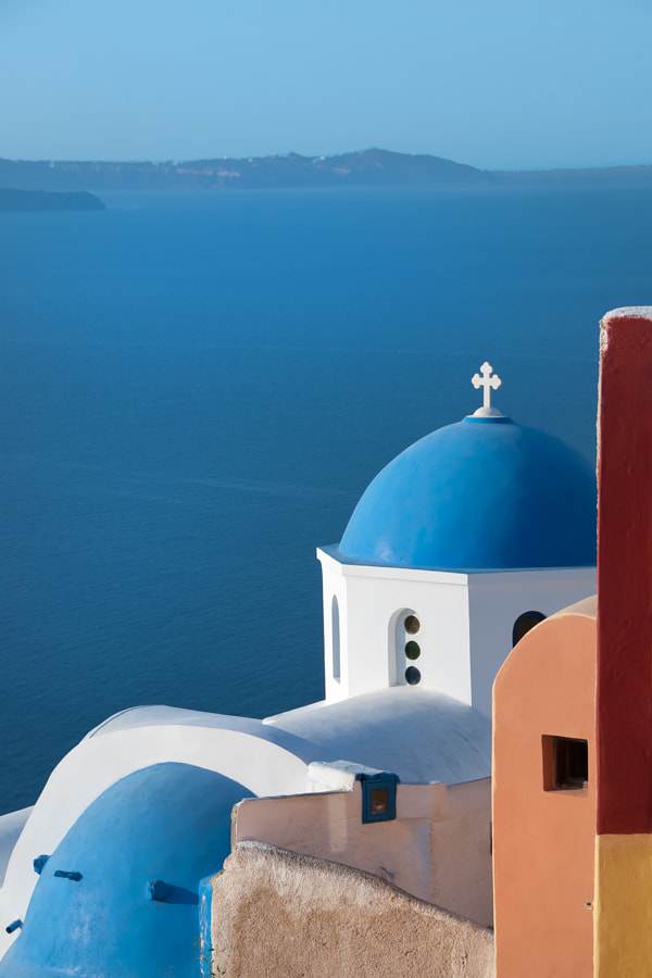 Oia, Santorini, Greece, Europe. Oia Domes and buildings with caldera in background.