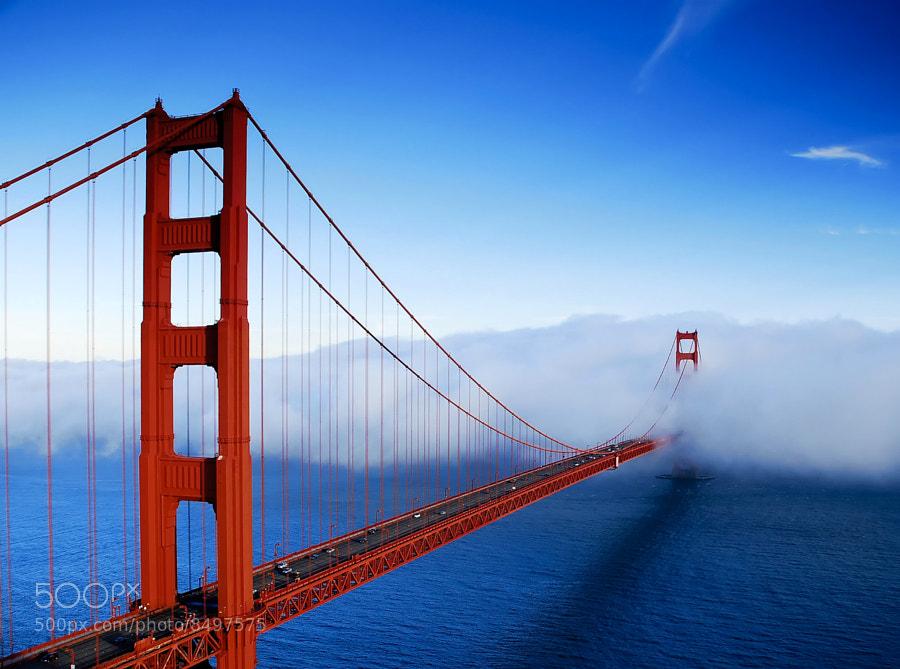 Golden Gate Bridge, San Francisco, California, USA. Golden Gate Bridge partially obscured by fog.