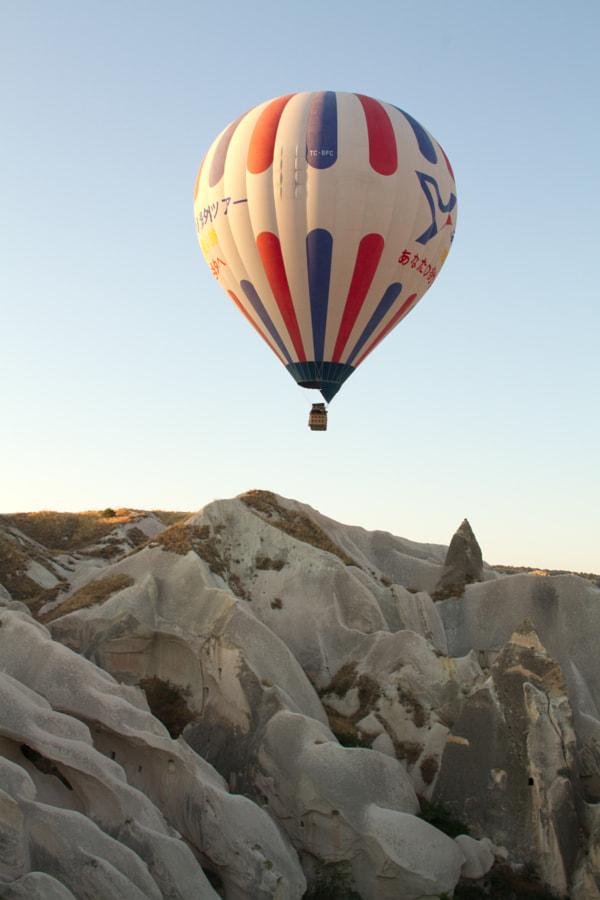 balloon rising over dune