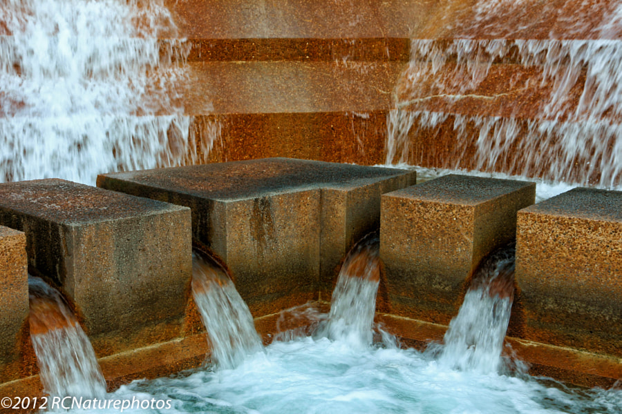 """""""Rushing Water"""" The beauty and the roar of rushing water as it cascades down the stone in the Fort Worth Water Gardens."""