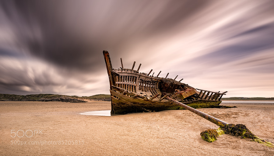 Photograph Old Shipwreck on Bunbeg Beach by Peter Krocka on 500px