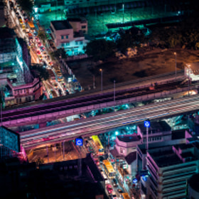 City lights and busy traffic over Bangkok, Thailand