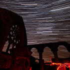 Постер, плакат: Startrail above the ruins of the Chapel Fil