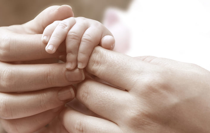 Baby hand holding mother's hands by Janet Weldon on 500px