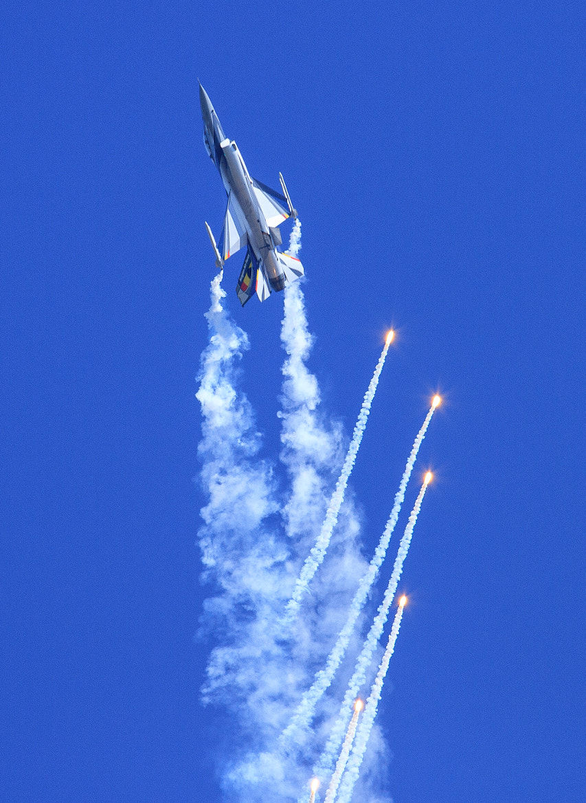 Photograph F16 Fires off Flares at Duxford by John Hill on 500px