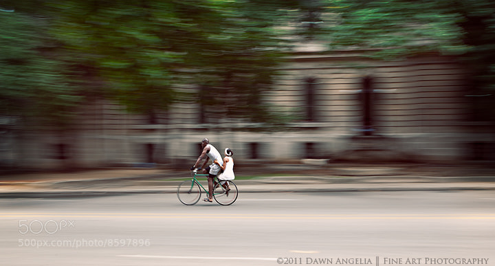 A man and woman share a bike, as cars are not an essential staple in this country.