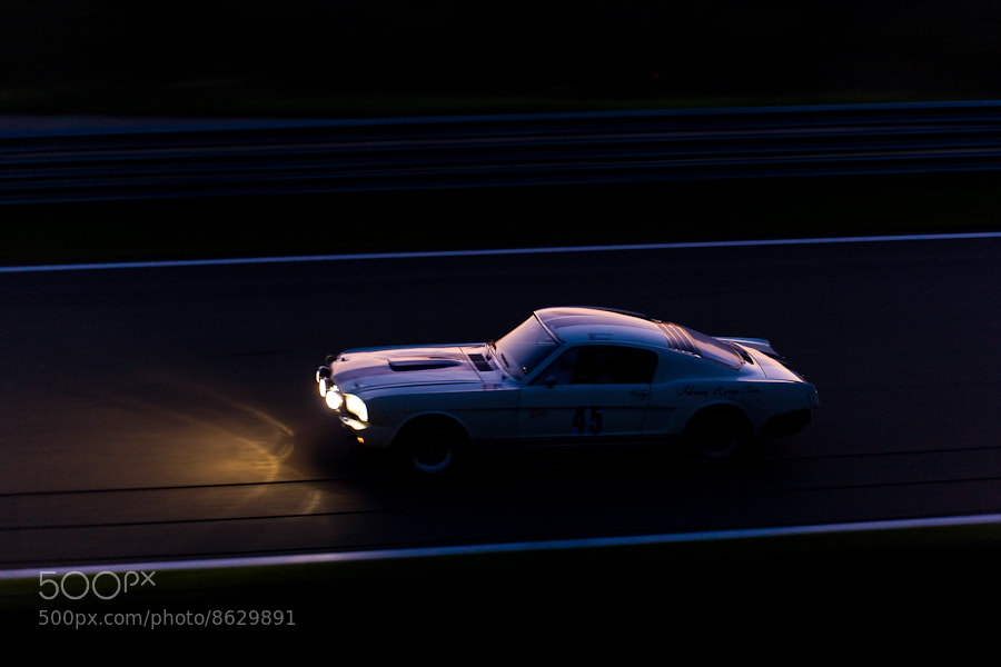 Photograph Mustang charging into the night by Tim Brown on 500px