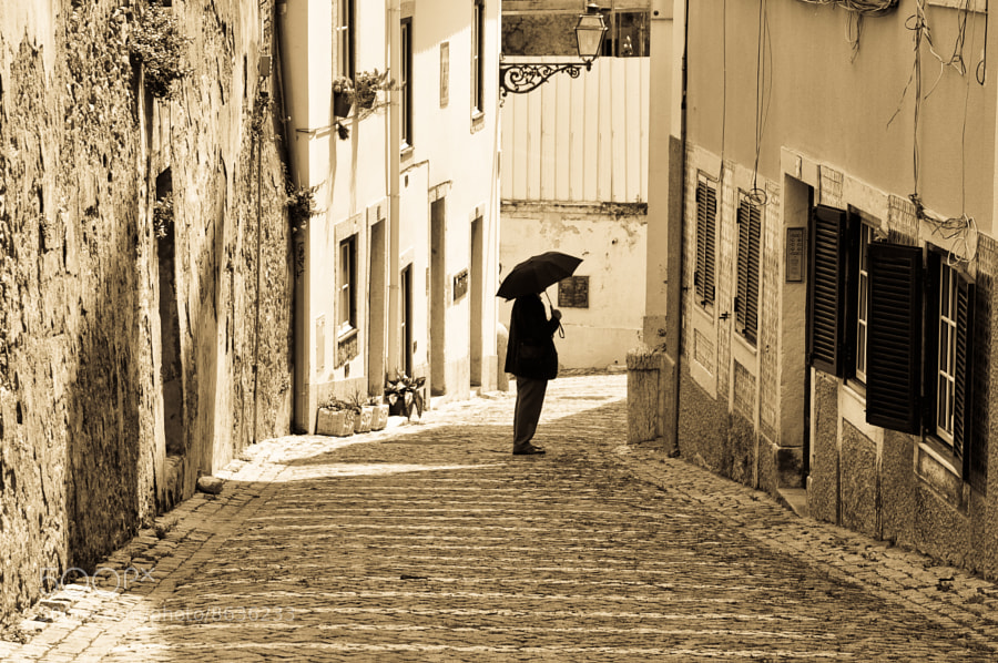 Photograph Walking with an Umbrella by Jose Antonio Castellanos on 500px