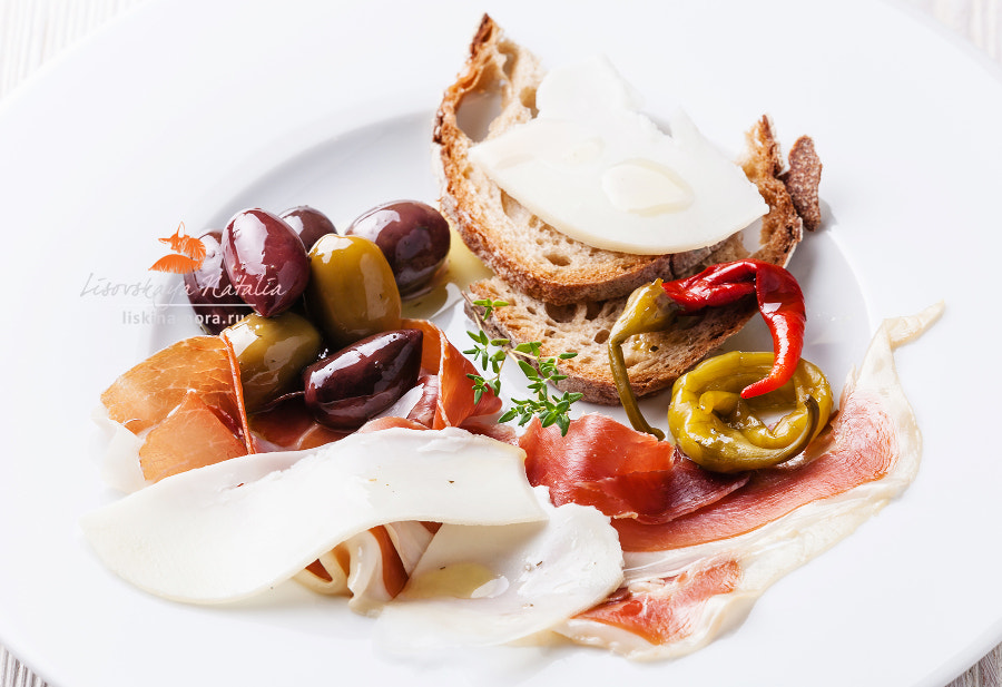 ham, cheese and olives on white plate