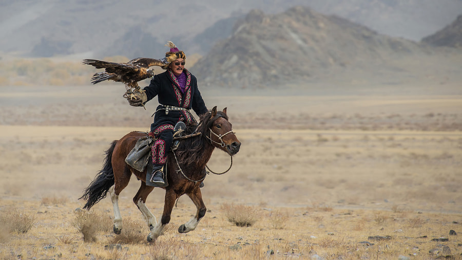 Eagle hunter on horse by Stefan Cruysberghs on 500px.com