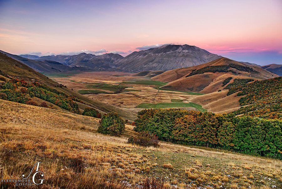 Autumn dusk slowly fading away above the Monte Vettore (2476m) and Piano Grande valley in the Italian Apennines