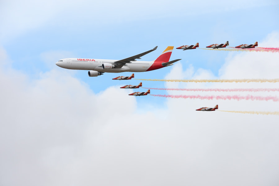 """Shot of this Iberia Airlines Airbus A330-302 guarded by Patrulla Águila taken on Friday the 10th of October during a special spotters day at Torrejón Air Base.  Torrejón Air Base (Base Aérea de Torrejón de Ardoz) is a major Spanish Air Force base and a secondary civilian airport for Madrid known as Madrid-Torrejón Airport.  Patrulla Águila (""""Eagle Patrol"""") is the aerobatic demonstration team of the Spanish Air Force, based at San Javier airbase near La Manga, in the Murcia region of Spain. Flying 7 Casa C-101 Aviojets, they are the only team to use yellow smoke, and are also known for their formation landings.  The team was formed on 4 July 1985.  Best regards,  Harry"""
