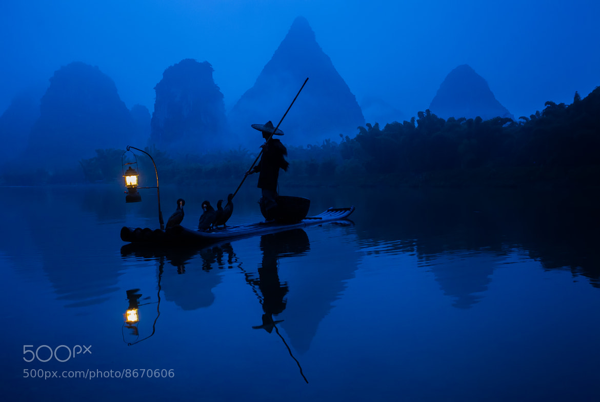 Photograph Fisherman on the Li River by Greg Annandale on 500px