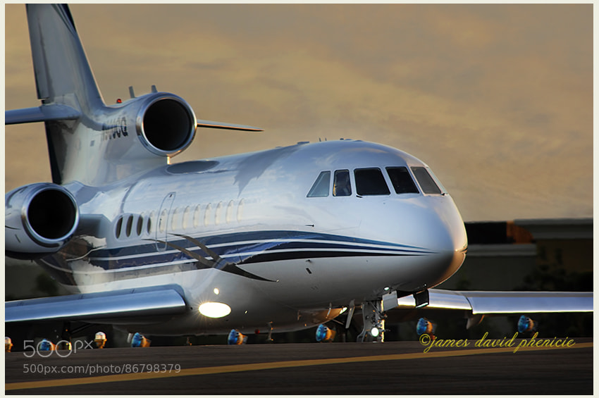 FALCON 900 EX getting ready for takeoff at local airport. [NOTE:  Please click on image to view on black.]  Please don't use this image on websites, blogs or other media without  my explicit permission.   ©2014 James David Phenicie   All rights reserved.