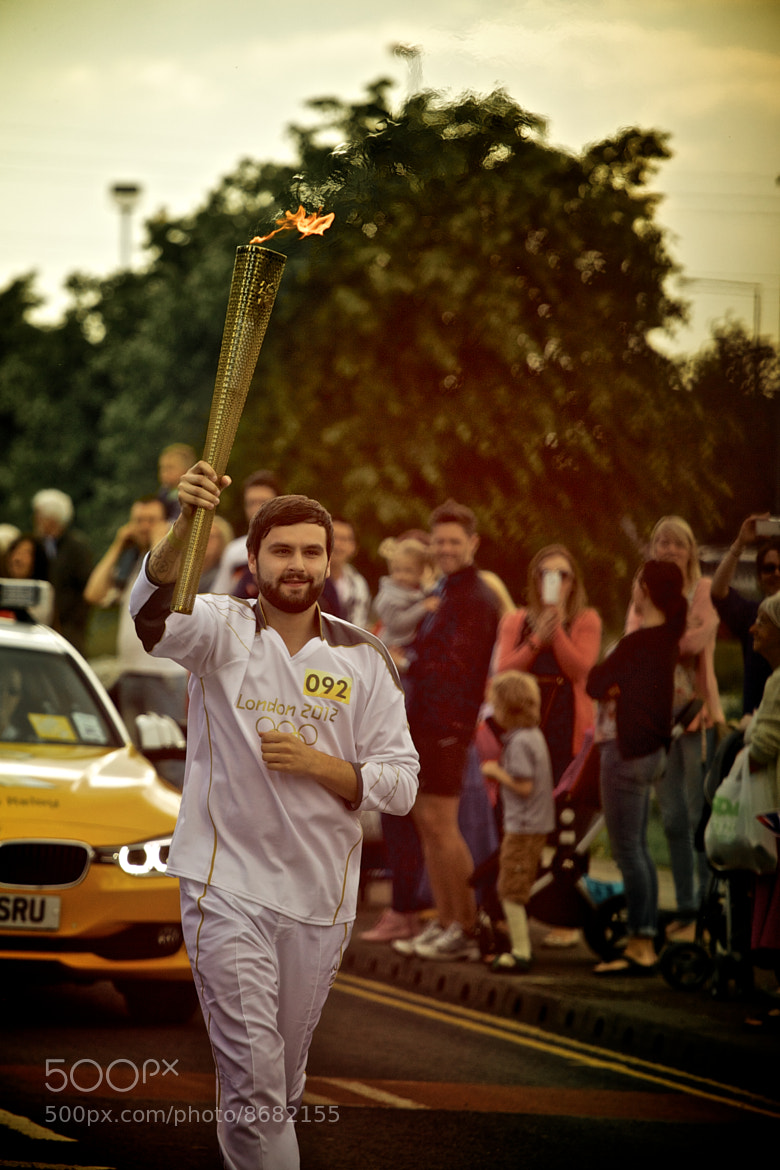 Photograph Olympic Torch Runner  by James Johnson on 500px