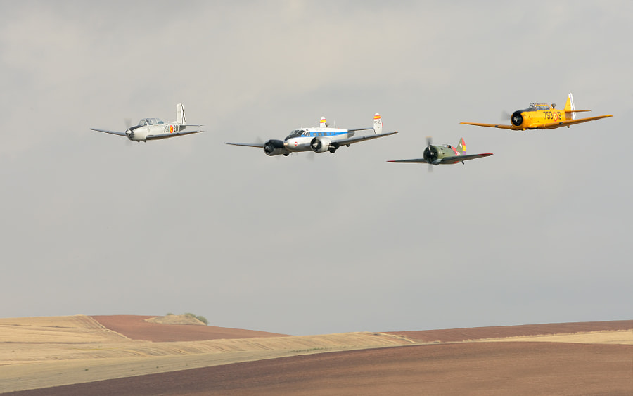 """Wonderful line up of old planes of the Fundacion Infante de Orleans with starting left a Beech T-34A Mentor , Spantax Beech C-45H Expeditor, Polikarpov I-16 Tipo 10 """"Supermosca"""" and a North American T-6G Texan.  Shot taken during Air75 on Torrejon Air Base near Madrid, Spain.  Regards and have a nice Sunday,  Harry"""