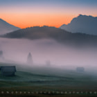 Sunrise over Karwendel Alps. Bavaria oct 2014. I arrived at Geroldsee in pitch dark and had to wait a few minutes before I found myself a spot on the fields overlooking the lake and the wonderful Alps in the background. As daylight slowly emerged, a dense morning fog formed over the lake and made a nice foreground to the promising sunrise.