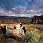 I shot this a few years ago in the Alvord desert in southeastern Oregon. While driving from one shoot to another I looked out over the sage brush and barely saw the peak of the this crumbling shack. What a treat it was to hike out to it and see the beautiful seen. Thanks for looking.