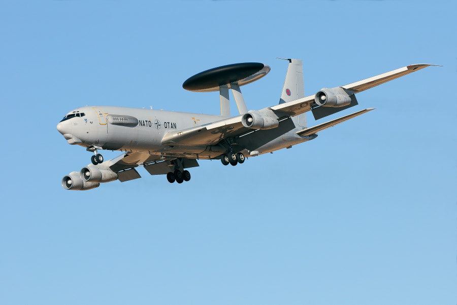 An aircraft one doesn't become to see every day.  Luxembourg - NATO Boeing E-3A Sentry (707-300)  incoming after a practice session during Tactical Leadership Programme (TLP) based at Los Llanos Air Base, Albacete, Spain.   The E-3 Sentry is an airborne warning and control system (AWACS) aircraft that provides all-weather surveillance, command, control and communications needed by commanders of U.S. and NATO air defense forces. As proven in Desert Storm, it is the premier air battle command and control aircraft in the world today. The E-3 Sentry is a modified Boeing 707/320 commercial airframe with a rotating radar dome. The dome is 30 feet (9.1 meters) in diameter, six feet (1.8 meters) thick, and is held 11 feet (3.3 meters) above the fuselage by two struts. It contains a radar subsystem that permits surveillance from the Earth's surface up into the stratosphere, over land or water. The radar has a range of more than 200 miles (320 kilometers) for low-flying targets and farther for aerospace vehicles flying at medium to high altitudes. The radar combined with an identification friend or foe subsystem can look down to detect, identify and track enemy and friendly low-flying aircraft by eliminating ground clutter returns that confuse other radar systems.  Best regards and have a nice day,  Harry