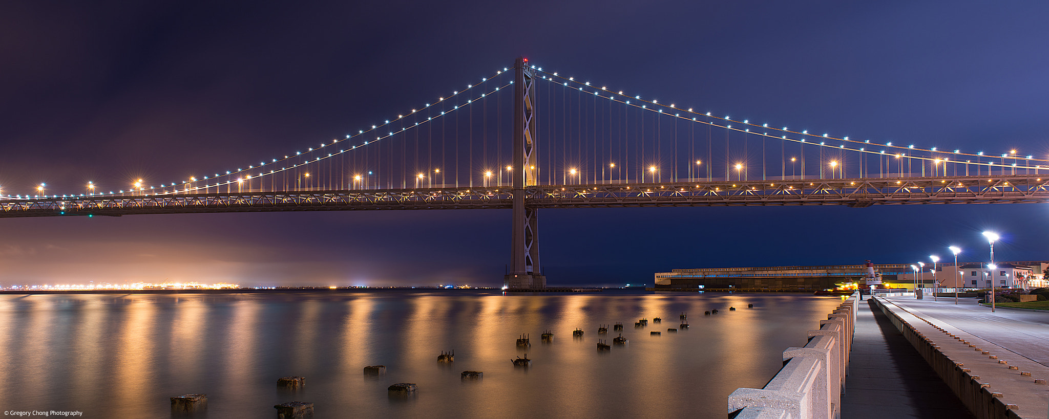Photograph The San Francisco Bay Bridge at the Embarcadero by Gregory Chong on 500px
