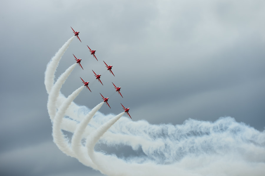 On a dark dull day these great guys of the Red Arrows brought a little joy in life.  Shot taken during the RIAT Air Show at Fairford AFB.  Regards and have a nice day,  Harry