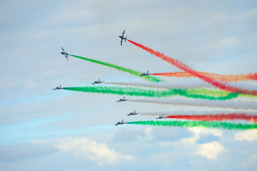 The team's official name is: 313° Gruppo Addestramento Acrobatico, Pattuglia Acrobatica Nazionale (PAN) Frecce Tricolori.  On July 1st 1961, at Rivolto air base, the 313th Aerobatic Training Group was officially born. The establishment of an official national aerobatics team (Pattuglia Acrobatica Nazionale i.e. P.A.N.) stemmed from the decision of the military head quarters to concentrate the know how of demonstrating both the pilots and the aircrafts ability with the drive to make it perfect and at the same time to rationalize the employment of both human resources and aircraft.  Shot taken during the 2914 RIAT Air Show at Fairford AFB.  Regards and have a nice day,  Harry