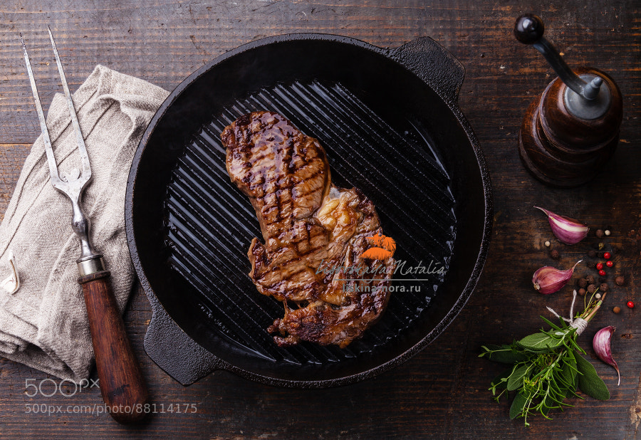Grilled Ribeye steak entrecote on grill pan