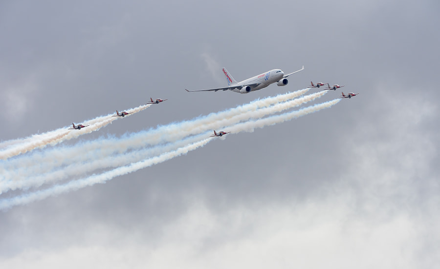 """An Air Europe Airbus A330-200 guarded by the Spanish Patrulla Águila. at Torrejón Air Base.  ©<a href=""""http://www.hewaph.com"""">hewaph</a>  Torrejón Air Base (Base Aérea de Torrejón de Ardoz) is a major Spanish Air Force base and a secondary civilian airport for Madrid known as Madrid-Torrejón Airport.  Patrulla Águila (""""Eagle Patrol"""") is the aerobatic demonstration team of the Spanish Air Force, based at San Javier airbase near La Manga, in the Murcia region of Spain. Flying 7 Casa C-101 Aviojets, they are the only team to use yellow smoke, and are also known for their formation landings.  The team was formed on 4 July 1985.  Best regards and have a great weekend,  Harry"""